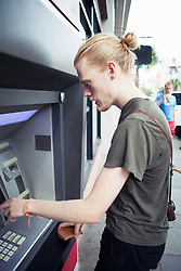 Oct. 7, 2014 - Young man using cash machine (Credit Image: © Image Source/Image Source/ZUMAPRESS.com)