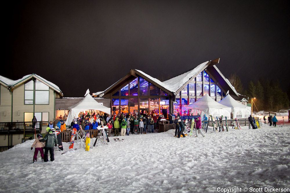 A crowd gathered outside and inside the Sitzmark Bar and Grill to watch the Big Air competition at Alyeska Resort's Frostbite Festival in Girdwood, Alaska.