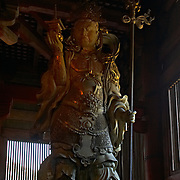 One of the four guardian kings protecting the Todaiji temple in the ancient capital of Nara, Japan.<br /> <br /> This is &quot;Tamonten&quot; also called &quot;Bishamonten&quot;, who is the guardian of the North.  He carries a treasure pagoda [&quot;houtou&quot;] and a three-pronged lance [&quot;sansageki&quot;] in the other.
