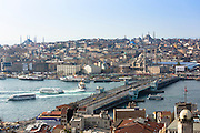 Yeni Camii, the Great Mosque, Blue Mosque behind, Hagia Sophia (left) Golden Horn ferry boats Bosphorus River, Istanbul, Turkey