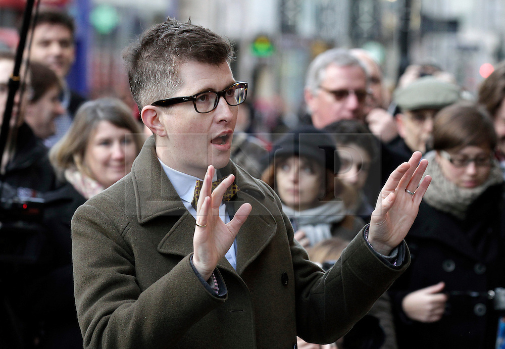 © Licensed to London News Pictures. 20/12/2011. London, United Kingdom .Gareth Malone sings along with the Military Wives Choir outside of HMV on Oxford Street to celebrate the success of their single..Photo credit : Chris Winter/LNP