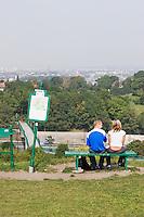 Couple sit admiring the view from the Krakus Mound in Podgorze Krakow Poland