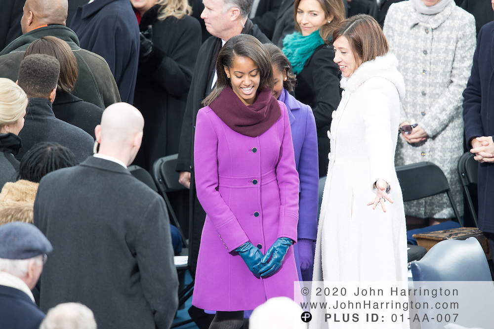 Sasha and Malia Obama arrive at the 57th Presidential Inauguration of President Barack Obama at the U.S. Capitol Building in Washington, DC January 21, 2013.