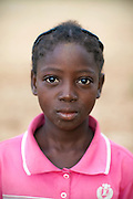 In the early morning, Hassana Ibrahim, 11, is portrayed during a break from collecting a load of Shea nuts to help supporting her family, in Boggu, Tamale, northern Ghana.