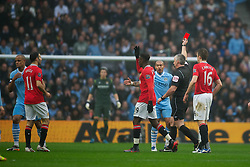 MANCHESTER, ENGLAND - Sunday, January 8, 2012: Manchester City's Vincent Kompany is shown the red card by referee Chris Foy and sent off during the FA Cup 3rd Round match against Manchester United at the City of Manchester Stadium. (Pic by David Rawcliffe/Propaganda)