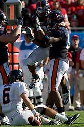 Virginia defensive end Jeffrey Fitzgerald (95) (right) celebrates with NT Nate Collins (98) and defensive end Chris Long (91) after sacking Texas Tech quarterback Graham Harrell (6).  The Texas Tech Red Raiders defeated the Virginia Cavaliers 31-28 in the 2008 Konica Menolta Gator Bowl held at the Jacksonville Municipal Stadium in Jacksonville, FL on January 1, 2008.
