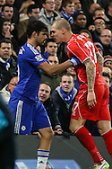 Martin Skrtel of Liverpool (right) and  Diego Costa of Chelsea (left) square up to each other during the Capital One Cup Semi Final 2nd Leg match between Chelsea and Liverpool at Stamford Bridge, London, England on 27 January 2015. Photo by David Horn.