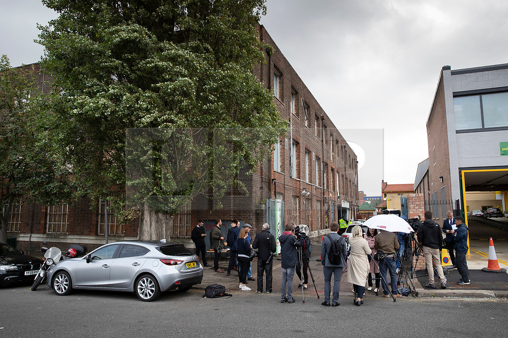© Licensed to London News Pictures. 19/09/2018. London, UK. Reporters and TV crews gather at the entrance to The Hussaini Association Islamic Centre in Cricklewood, north London where a car hit two pedestrians last night. The incident , which took place in the early hours of this morning outside the centre, is being treated as a possible hate crime. Police are looking for a male driver who failed to stop at the scene, as well as two men and one woman in the car, all in their 20s. Photo credit: Peter Macdiarmid/LNP