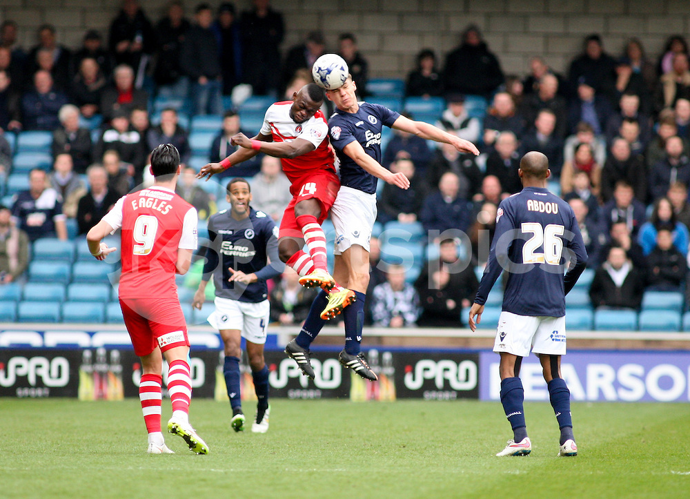 Igor Vetokele of Charlton Athletic and Sid Nelson of Millwall challenge for a header during the Sky Bet Championship match between Millwall and Charlton Athletic at The Den, London, England on 3 April 2015. Photo by Edmund  Boyden.