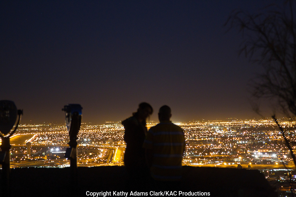 People watching the city lights of El Paso, Texas, from Scenic Drive on the Franklin Mountains.