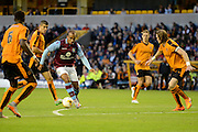 Gabriel Agbonlahor lines up a shot watched by Richard Stearman during the Pre-Season Friendly match between Wolverhampton Wanderers and Aston Villa at Molineux, Wolverhampton, England on 28 July 2015. Photo by Alan Franklin.