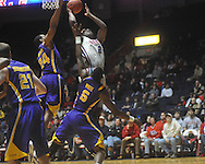 "Ole MIss forward Reginald Buckner (2)  is defended by Louisiana State's Malcolm White (5) at the C.M. ""Tad"" Smith Coliseum in Oxford, Miss. on Wednesday, February 9, 2011. Ole Miss won 66-60 and is now 4-5 in the Southeastern Conference."