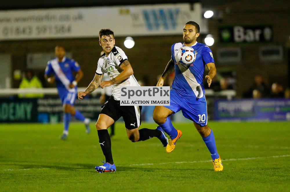 Dover's defender Sam Magri (2) eyes up the ball from Eastleigh's midfielder Jai Reason (10). Dover Athletic v Eastleigh. Vanarama National League. 10  November 2015. (c) Matt Bristow | SportPix.org.uk