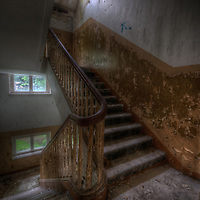 An abandoned Soviet sports hospital in East Germany with decaying stairway