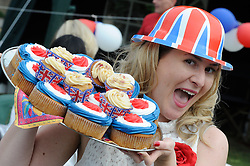 Orpington, UK  29/04/2011. The Royal Wedding of HRH Prince William to Kate Middleton..Street party,Hillview Crescent,Orpington,South East London, celebrating the Royal Wedding..Lucy Cobb (Resident)with her tray of cakes..Photo credit should read Grant Falvey/LNP. Please see special instructions. © under license to London News Pictures