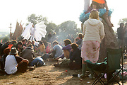 People at the stone circle, including two people in costume, Glastonbury 2005