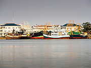 24 MARCH 2015 - MAHACHAI, SAMUT SAKHON, THAILAND: Fishing boats tied up in port on the Tha Chin River in Samut Sakhon (also called Mahachai) Thailand. Samut Sakhon is the center of the Thai fishing industry.     PHOTO BY JACK KURTZ