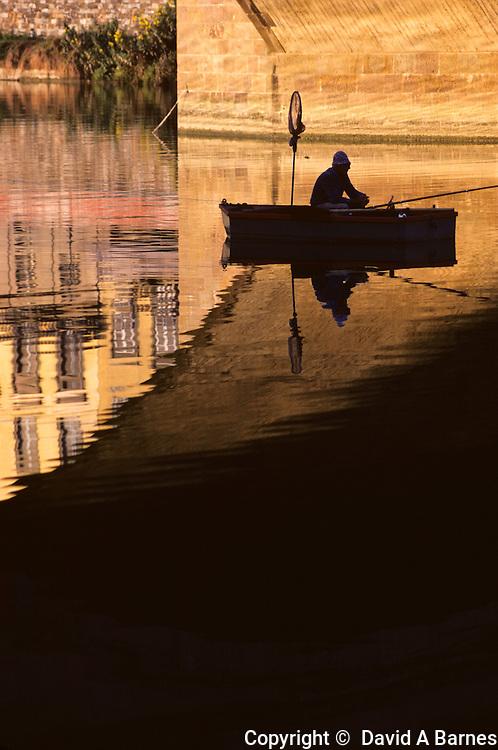 Sport fishing under Ponte Santa Trinta, Arno, Florence, Tuscany, Italy