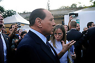 Italian Prime Minister Silvio Berlusconi  talks with Giorgia Meloni, Italian Minister of Youth, during the opening of the first national meeting of the young people of the PDL (People of Freedom)