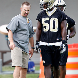 May 31, 2012; Metairie, LA, USA; New Orleans Saints defensive coordinator Steve Spagnuolo works with linebacker Curtis Lofton (50) during organized team activities at the team's practice facility. Mandatory Credit: Derick E. Hingle-US PRESSWIRE