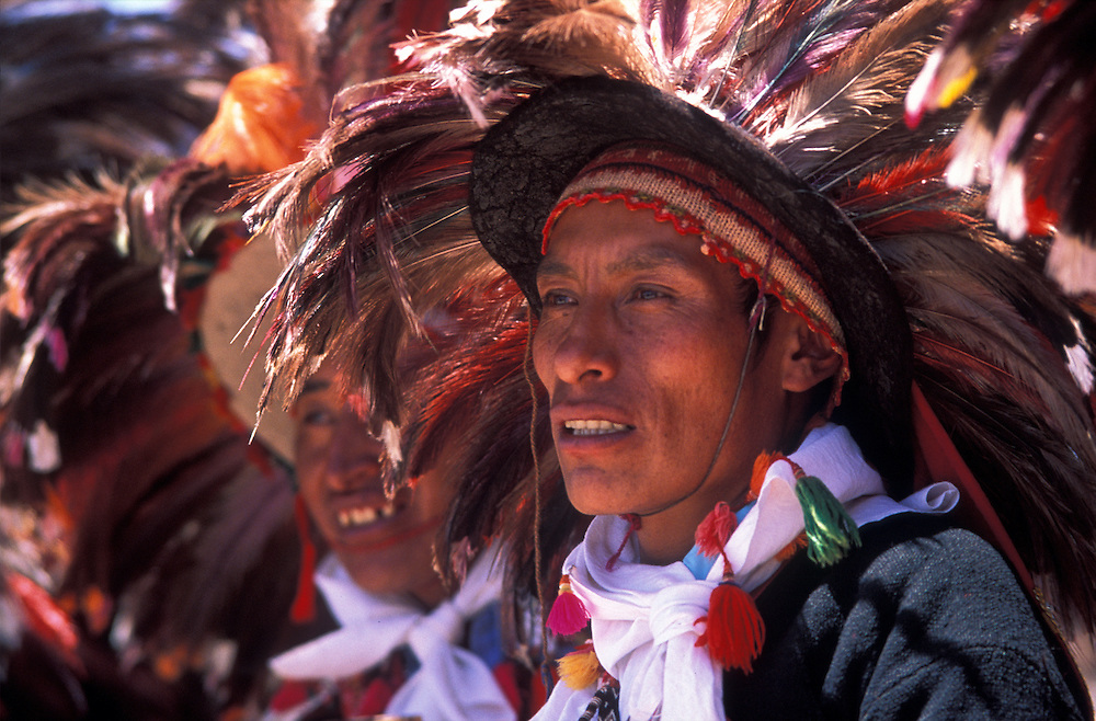 Dancers wear condor feathers in their traditional headdresses, Puno Festival.