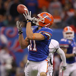 Jan 01, 2010; New Orleans, LA, USA;  Florida Gators wide receiver Riley Cooper (11) catches a touchdown pass against the Cincinnati Bearcats during the first half of the 2010 Sugar Bowl at the Louisiana Superdome.  Mandatory Credit: Derick E. Hingle-US PRESSWIRE.