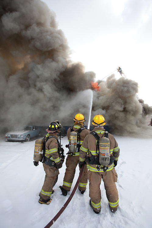 Muncie firefighters tackle a fire at North American Muffler on South Walnut Street in Muncie, Ind. Friday January 28..(Chris Bergin/The Star Press)...