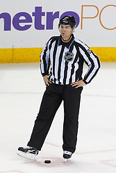 Dec 15, 2011; San Jose, CA, USA; NHL linesman Scott Cherrey (50) before a face off between the San Jose Sharks and the Colorado Avalanche during the third period at HP Pavilion.  San Jose defeated Colorado 5-4. Mandatory Credit: Jason O. Watson-US PRESSWIRE
