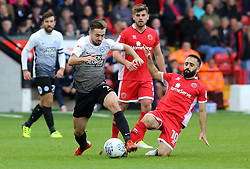 Gwion Edwards of Peterborough United skips past a challenge from Erhun Oztumer of Walsall - Mandatory by-line: Joe Dent/JMP - 16/09/2017 - FOOTBALL - Banks's Stadium - Walsall, England - Walsall v Peterborough United - Sky Bet League One