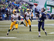 Seattle Seahawks punter Jon Ryan (9) is chased by Green Bay Packers cornerback Davon House (31) as he yells out and throws a third quarter touchdown pass on a fake punt that cuts the Green Bay Packers lead to 16-7 during the NFL week 20 NFC Championship football game against the Green Bay Packers on Sunday, Jan. 18, 2015 in Seattle. The Seahawks won the game 28-22 in overtime. ©Paul Anthony Spinelli