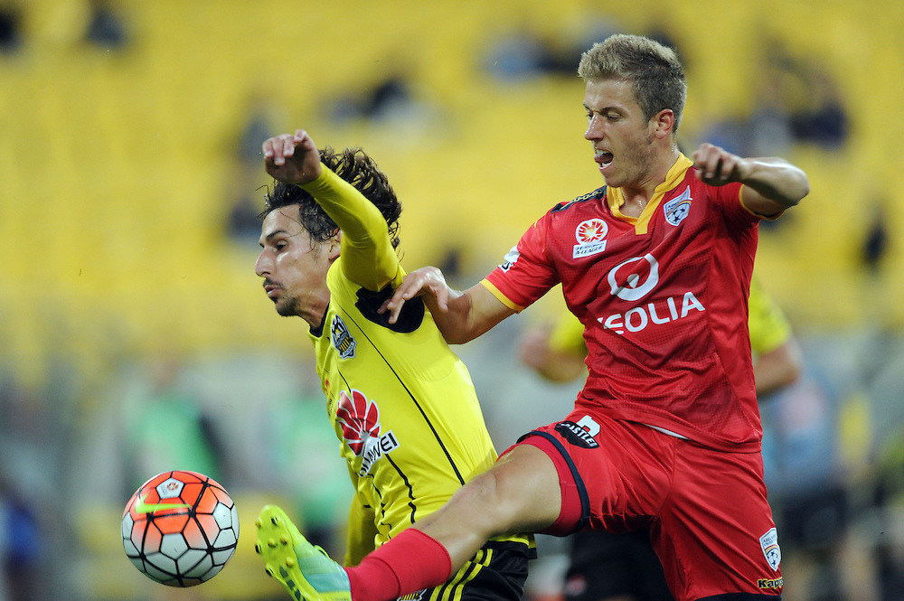 Adelaide United's Stefan Malik, right, contests the ball with Phoenix's Albert Riera in the A-League football match at Westpac Stadium, Wellington, New Zealand, Saturday, March 05, 2016. Credit:SNPA / Ross Setford