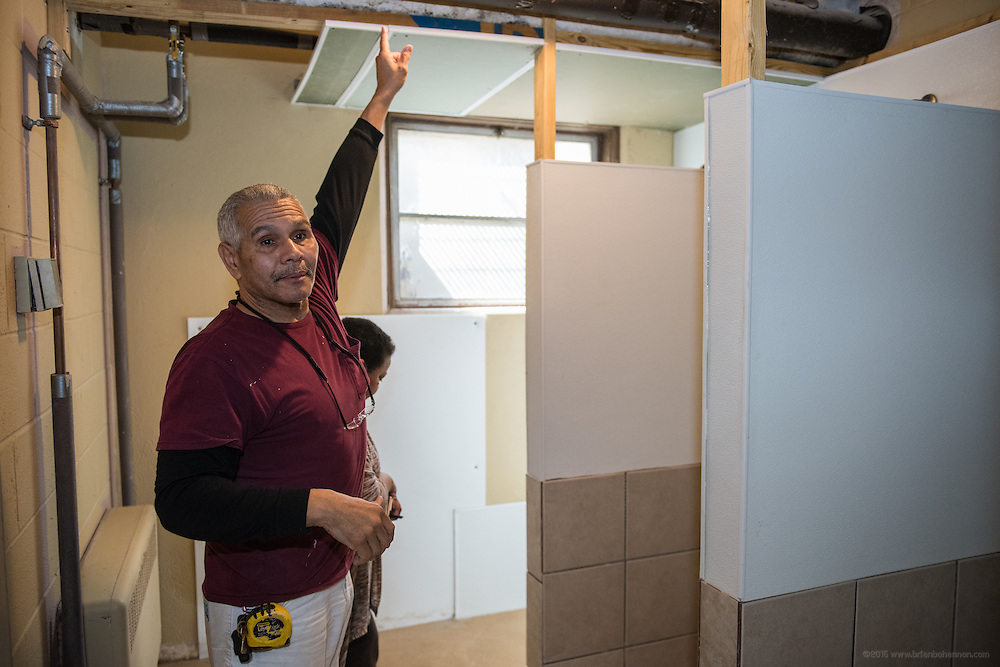 Gisela Nelson, executive director of New Legacy Reentry Corp,, and husband Paul Nelson, Sr., show the remodeling work completed in the building where New Legacy is housed. They have seven community members living in their building on Garvin Place. (Photo by Brian Bohannon)