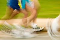 runners during a marathon race on the city streets in blurred motion showing speed.