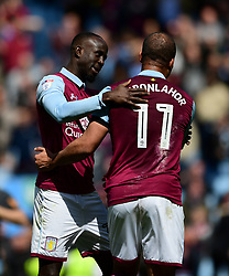 Gabriel Agbonlahor of Aston Villa celebrates  on the final whistle with Albert Adomah of Aston Villa  - Mandatory by-line: Joe Meredith/JMP - 23/04/2017 - FOOTBALL - Villa Park - Birmingham, England - Aston Villa v Birmingham City - Sky Bet Championship