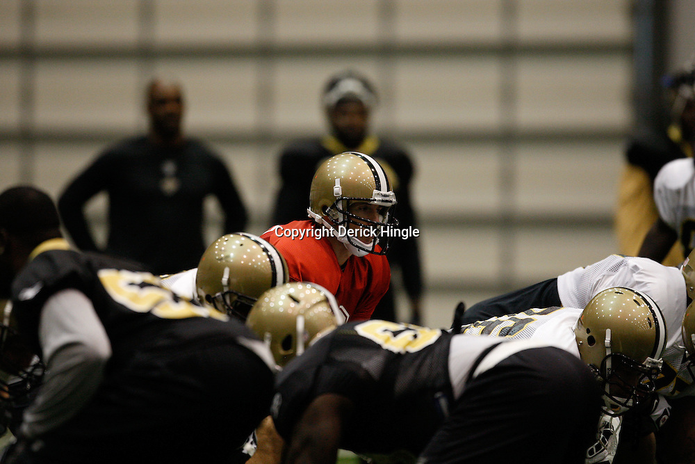 July 30, 2010; Metairie, LA, USA; New Orleans Saints quarterback Drew Brees (9) during a training camp practice at the New Orleans Saints practice facility. Mandatory Credit: Derick E. Hingle
