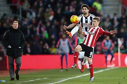 Claudio Yacob of West Bromwich Albion kicks the ball above Steven Davis of Southampton - Mandatory by-line: Jason Brown/JMP - 07966386802 - 16/01/2016 - FOOTBALL - Southampton, St Mary's Stadium - Southampton v West Bromwich Albion - Barclays Premier League