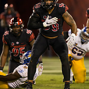 21 October 2016: The San Diego State Aztecs football team takes on the San Jose State Spartans Friday night at Qualcomm Stadium. San Diego State defensive linemen Alex Barrett (58) celebrates after making in the fourth quarter. The Aztecs beat the Spartans 42-3 to extend there home win streak. www.sdsuaztecphotos.com
