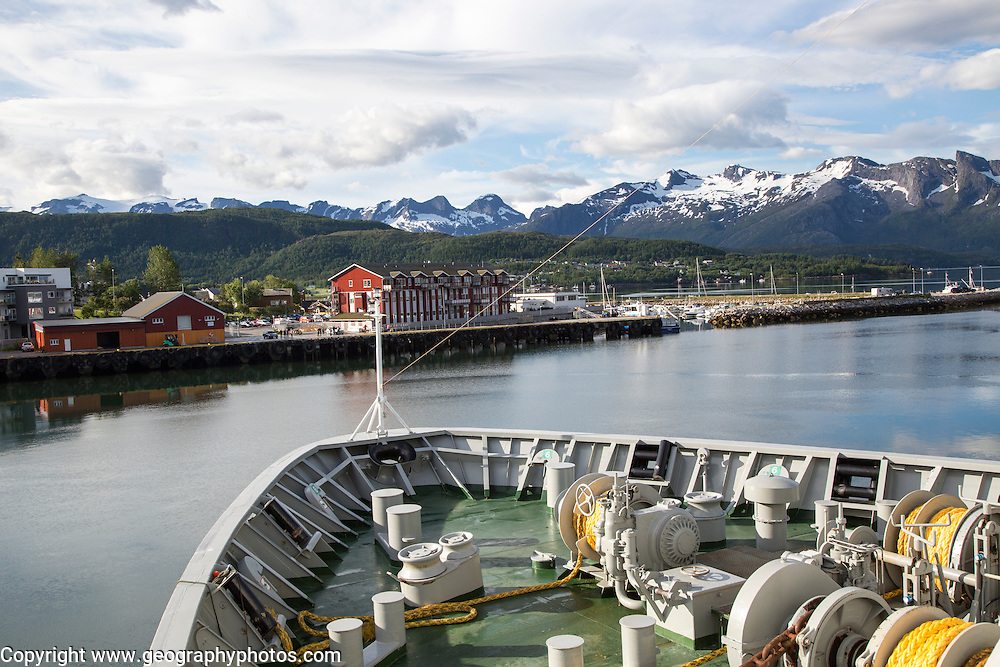 Bow of Hurtigruten ferry ship approaching marina Ornes, Nordland, Norway
