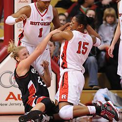 Feb 24, 2009; Piscataway, NJ, USA; Rutgers center Kia Vaughn (15) grabs a jump ball away from Cincinnati forward Jill Stephens (45) during the first half of Rutgers' 71-53 victory over Cincinnati at the Louis Brown Athletic Center.