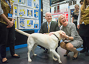 © Licensed to London News Pictures. 29/09/2014. Birmingham, UK. William Hague and his wife Ffion meet Nevis the guide dog at a trade stall.  The Conservative Party Conference in Birmingham 29th September 2014. Photo credit : Stephen Simpson/LNP