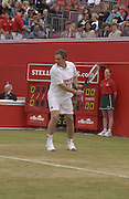 Tony Blair playing  in a charity tennis match in aid of Sport Relief. Stella Artois tennis Championships. The Queen's Club, London. 16 June 2002. © Copyright Photograph by Dafydd Jones 66 Stockwell Park Rd. London SW9 0DA Tel 020 7733 0108 www.dafjones.com