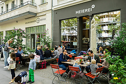 Busy cafe at brunch on Weekend in Prenzlauer Berg Berlin Germany