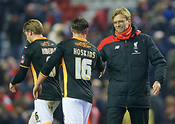 LIVERPOOL, ENGLAND - Wednesday, January 20, 2016: Liverpool's manager Jürgen Klopp shakes hands with Exeter City's Will Hoskins after the 3-0 victory during the FA Cup 3rd Round Replay match at Anfield. (Pic by David Rawcliffe/Propaganda)