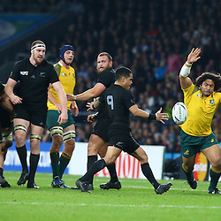 LONDON, ENGLAND - OCTOBER 31: Tatafu Polota-Nau of Australia looks to charge down Aaron Smith of New Zealand during the Rugby World Cup Final match between New Zealand vs Australia Final, Twickenham, London on October 31, 2015 in London, England. (Photo by Steve Haag)