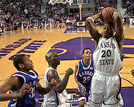 Kansas State's Cartier Martin (20) pulls down a rebound over Kansas center C. J. Giles (33) and guard Brandon Rush (25), during the first half at Bramlage Coliseum in Manhattan, Kansas, March 4, 2006.  The Jayhawks won 66-52.