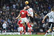 Nottingham Forest midfielder Pajtim Kasami (22)  and Derby County midfielder Bradley Johnson (15) battle in the air during the EFL Sky Bet Championship match between Derby County and Nottingham Forest at the iPro Stadium, Derby, England on 11 December 2016. Photo by Jon Hobley.