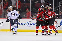 Jan 17; Newark, NJ, USA; The New Jersey Devils celebrate a goal by New Jersey Devils left wing Ilya Kovalchuk (17) during the first period at the Prudential Center.