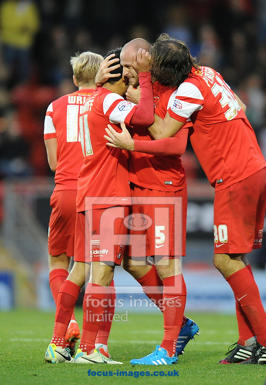 (left to right) Jobi McAnuff of Leyton Orient congratulates Scott Cuthbert after he scores the equaliser with Gianvito Plasmati during the Sky Bet League 1 match at the Matchroom Stadium, London<br /> Picture by Alan Stanford/Focus Images Ltd +44 7915 056117<br /> 01/11/2014