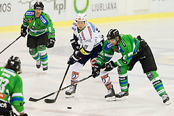 13.09.2015, Hala Tivoli, Ljubljana, SLO, EBEL, HDD Telemach Olimpija Ljubljana vs EC VSV, 2. Runde, in picture Patrick Platzer (EC VSV, #39) and Guillaume Desbiens (HDD Telemach Olimpija, #12) during the Erste Bank Icehockey League 2. Round between HDD Telemach Olimpija Ljubljana and EC VSV at the Hala Tivoli, Ljubljana, Slovenia on 2015/09/13. Photo by Urban Urbanc / Sportida