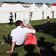 A couple kiss  during a day at the Races at Ascot Park, Invercargill, Southland, New Zealand. 10th December 2011. Photo Tim Clayton